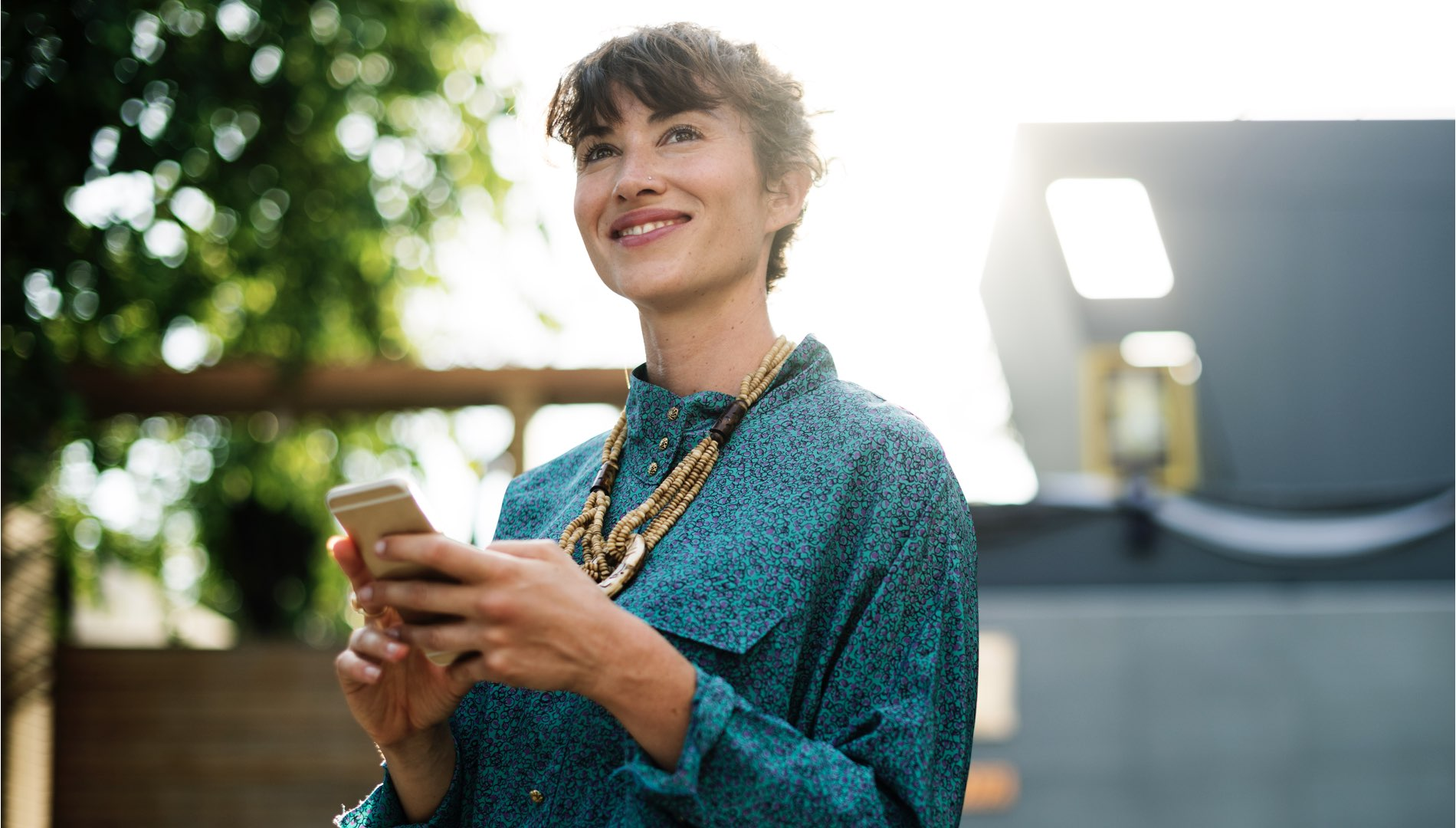 girl smiling with a smartphone